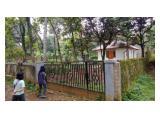 rumah dan pagar keliling